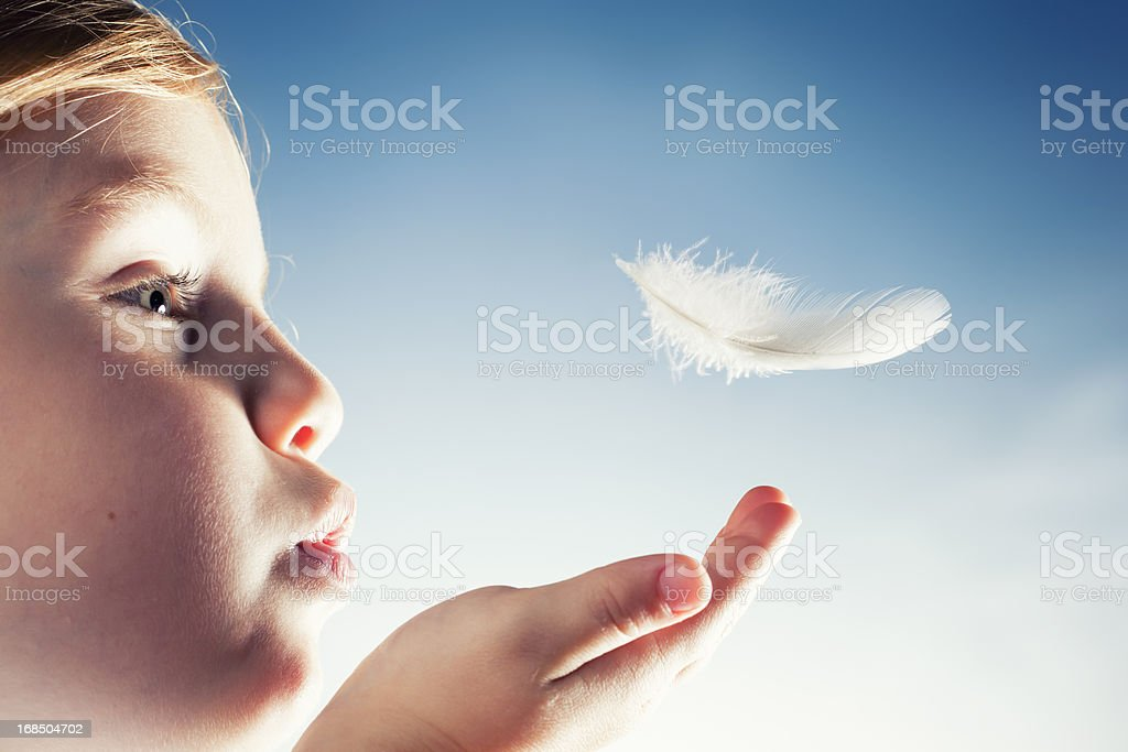 Blow away - Childhood Freedom Girl Ghild Feather stock photo
