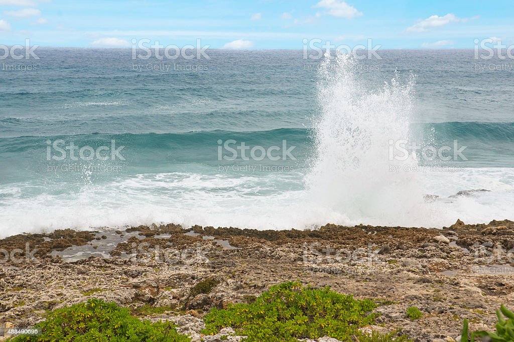 Blow Hole up on rocky coral shore in Cayman Islands stock photo