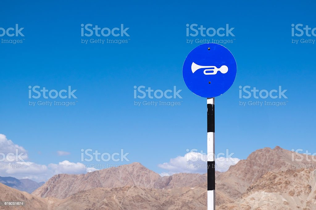 Blow horn sign stock photo