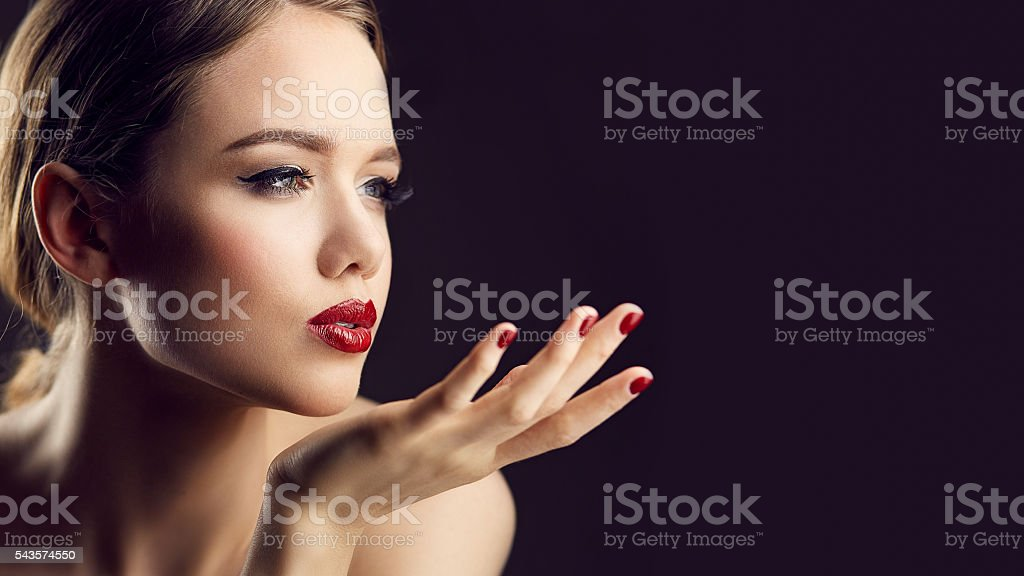 Blow kiss of red lips girl stock photo