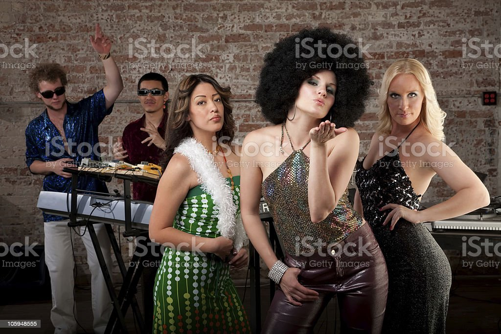 Blowing a kiss at 1970s Disco Music Party royalty-free stock photo