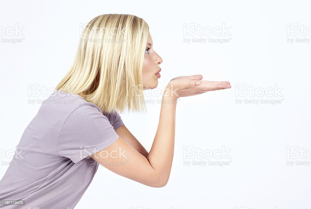 Blowing a kiss to your logo stock photo