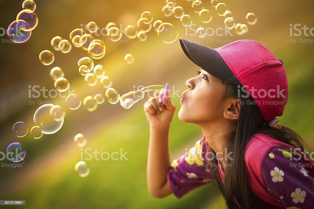 Blowing a soap bubbles stock photo