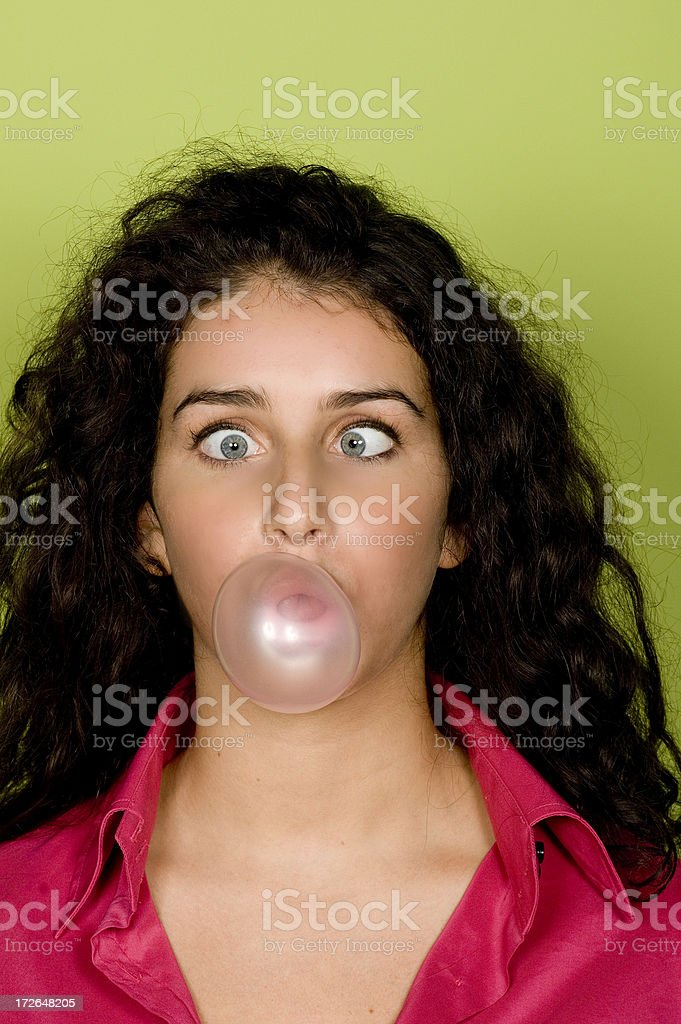 blowing bubble gum royalty-free stock photo