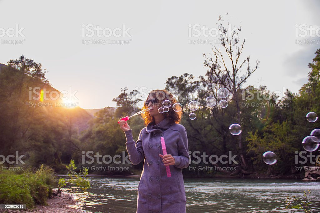 Blowing bubbles in nature royalty-free stock photo