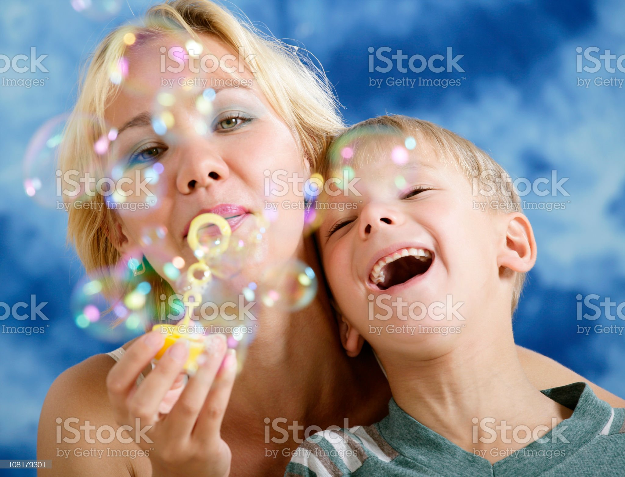Blowing bubbles together royalty-free stock photo