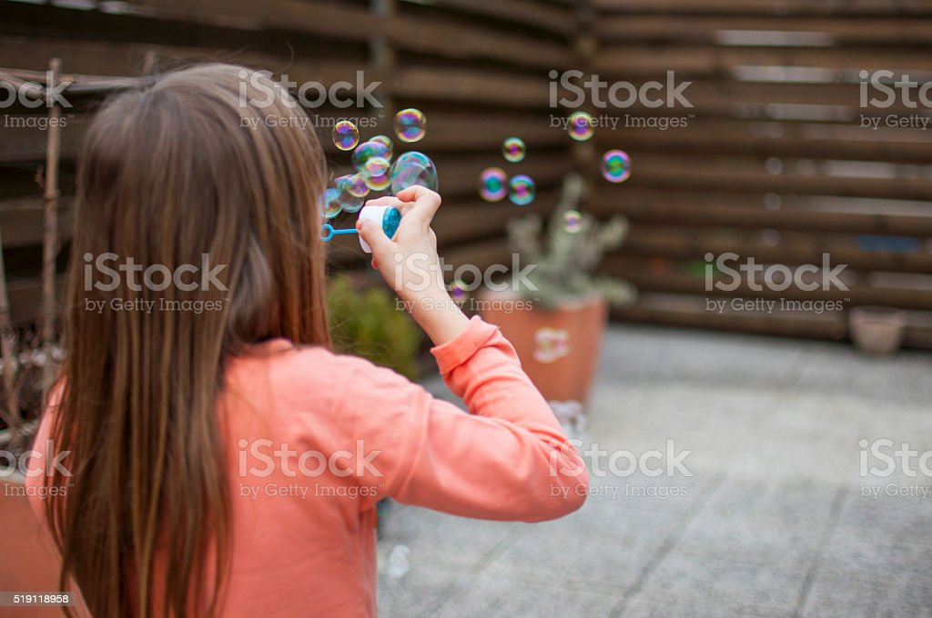 Blowing colorful bubbles stock photo