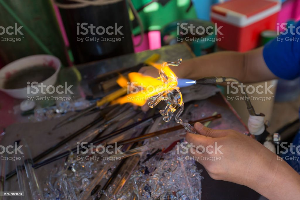 Blowing glass in a elephant shape. Handcrafting stock photo