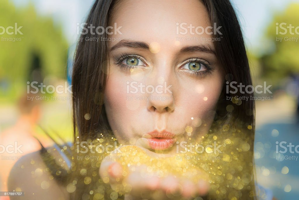 Blowing gold dust stock photo
