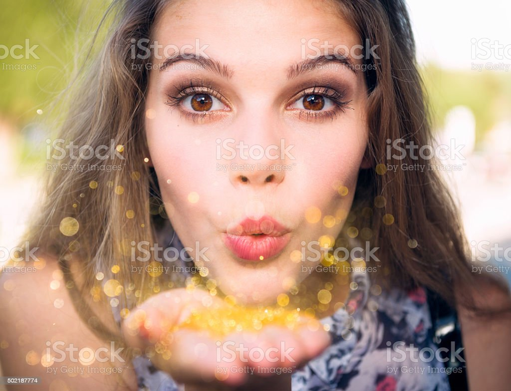 Blowing golden sparkles stock photo