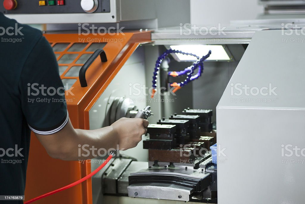 Blowing impurity during machining royalty-free stock photo