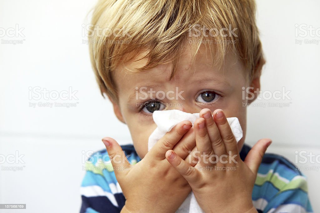 Blowing nose stock photo
