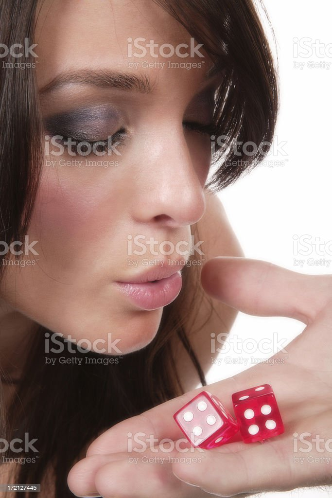 Blowing On Hot Dice III royalty-free stock photo