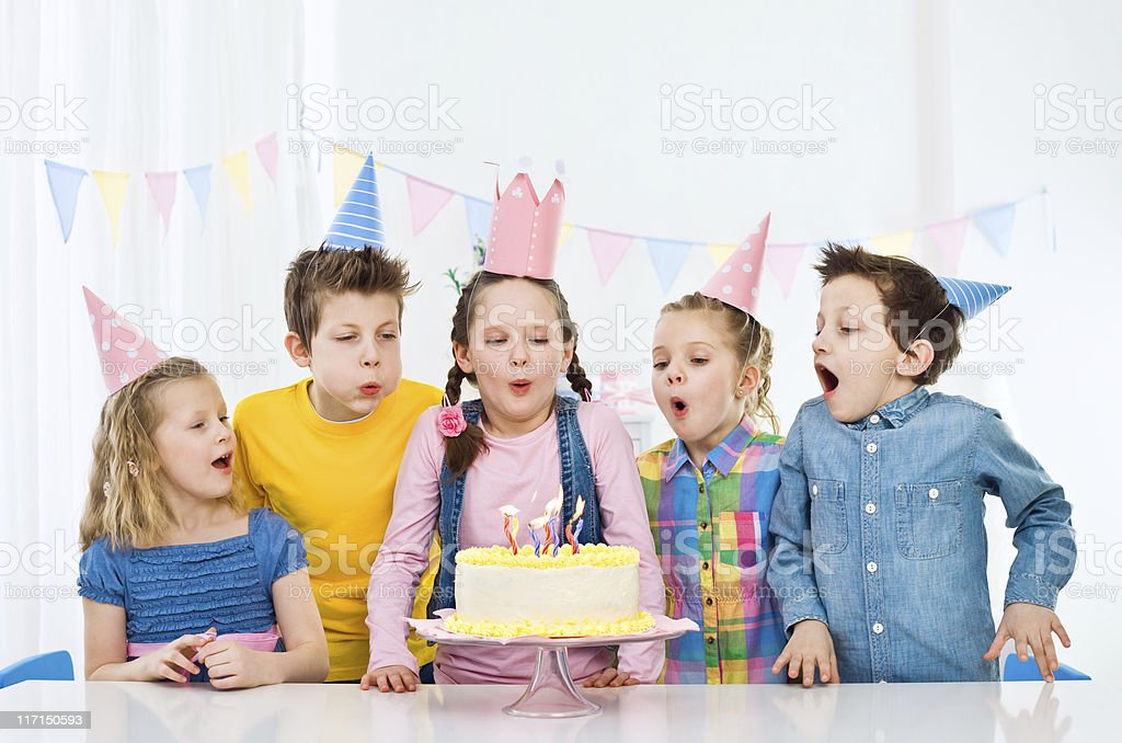 Blowing out birthday candles royalty-free stock photo