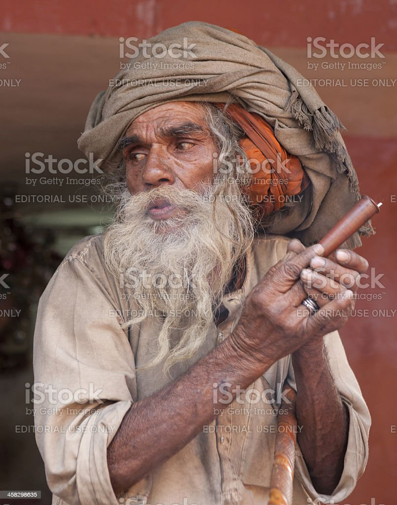 Blowing pilgrim at Kumbh Mela in Haridwar royalty-free stock photo