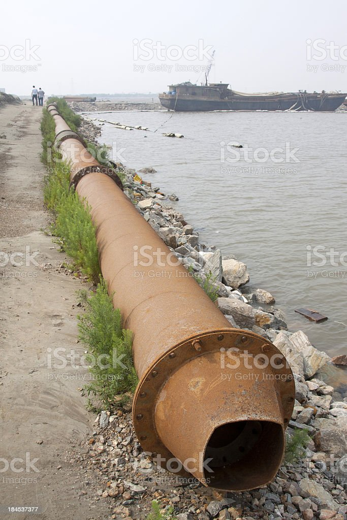 blowing sand pipe in the sea royalty-free stock photo