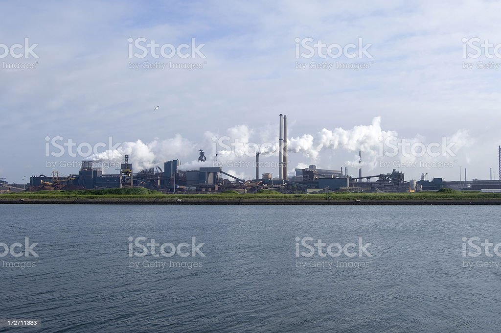 blowing smokestacks of heavy industrial plant stock photo