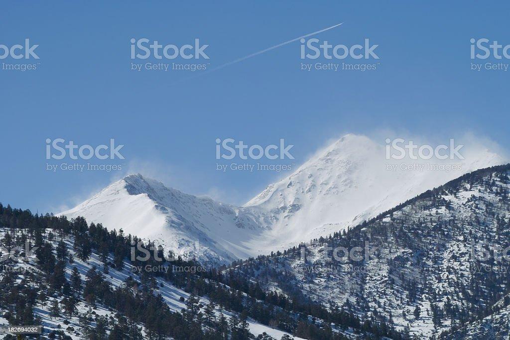 Blowing Snow on Mountain Peaks stock photo