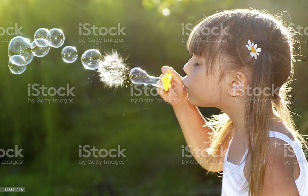Blowing soap bubbles stock photo