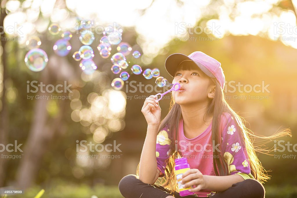 Blowing soap bubbles stock photo