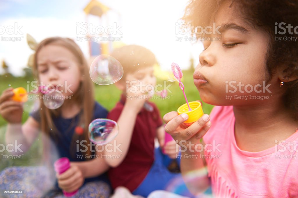 Blowing the bubbles with my friends stock photo