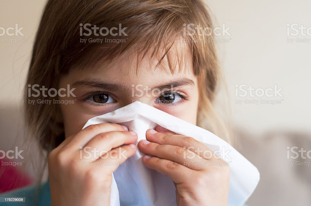 Blowing the nose royalty-free stock photo