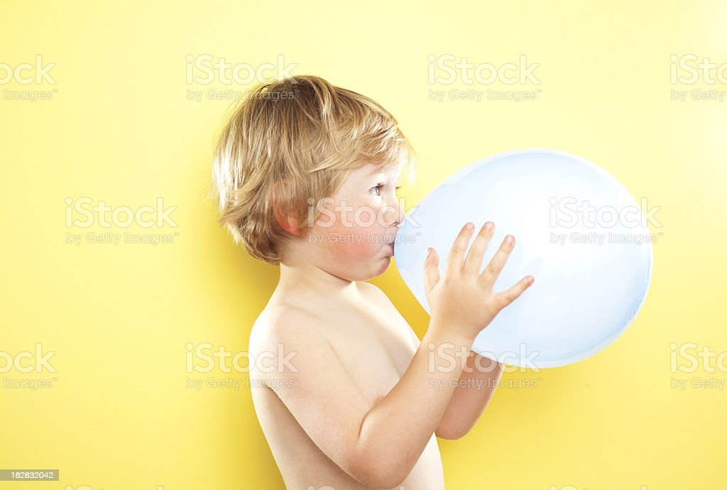 Blowing up balloon stock photo