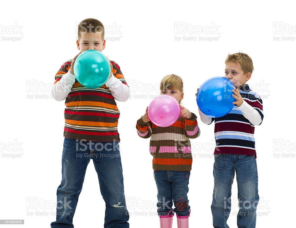 Blowing up toy balloons royalty-free stock photo