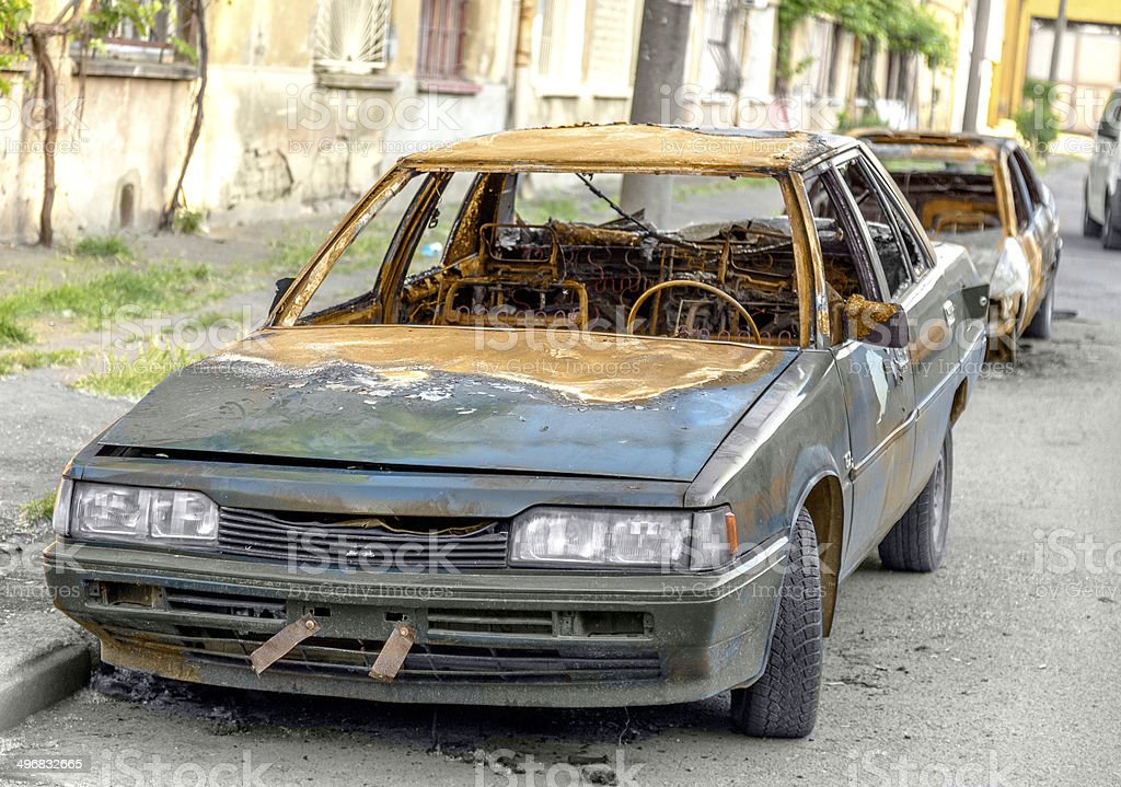 Blown car after civil strife thrown on the roadside. stock photo