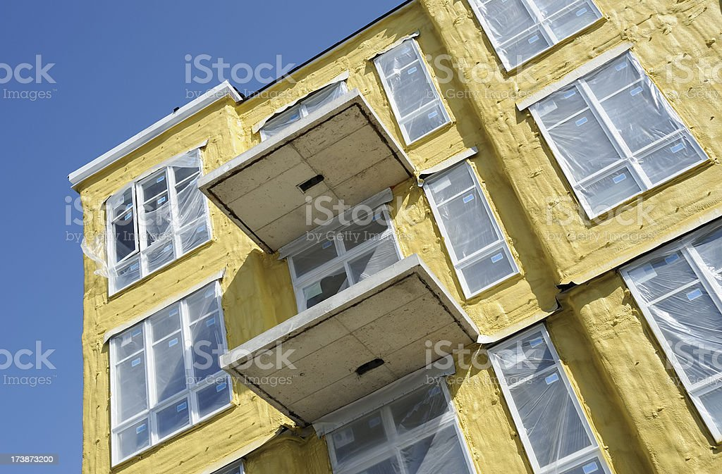 Blown foam insulation on building royalty-free stock photo