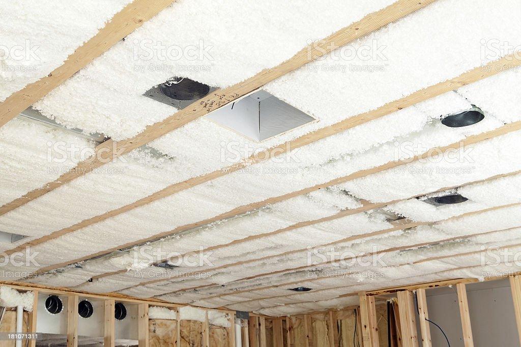 Blown Insulation Installed Between House Floor Joists stock photo