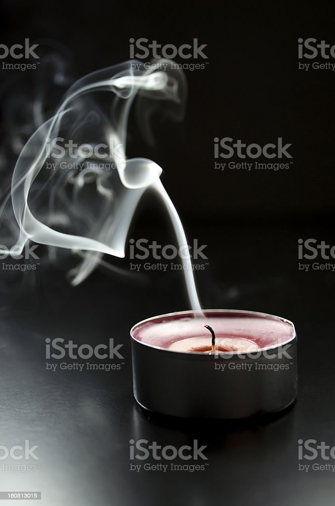 Blown out candle stock photo