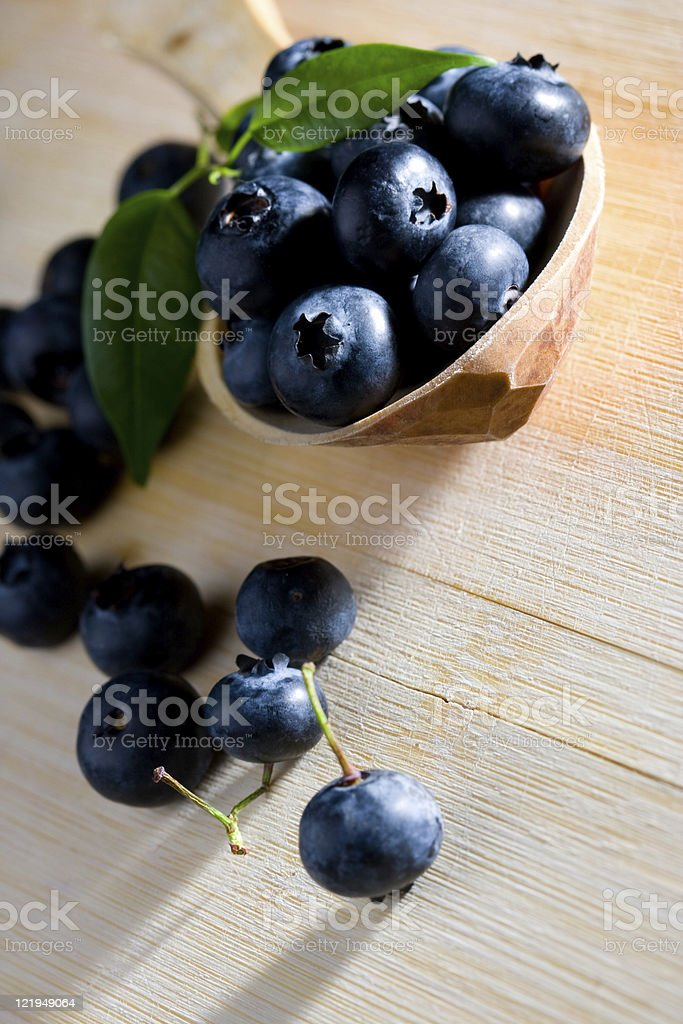 Bluberries on wood stock photo