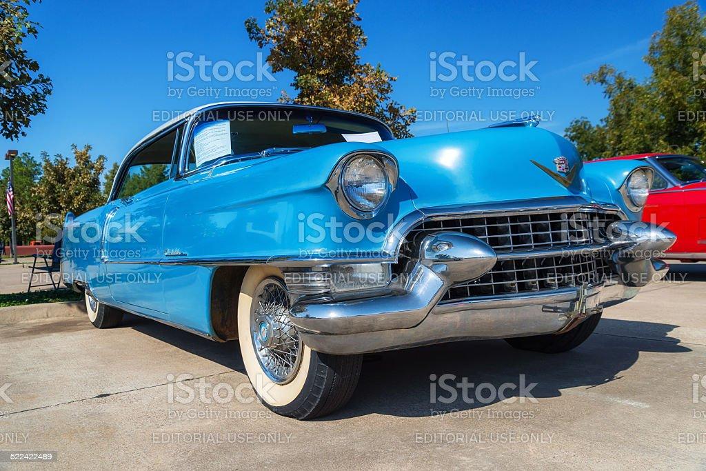 Blue 1955 Cadillac Coupe DeVille classic car stock photo