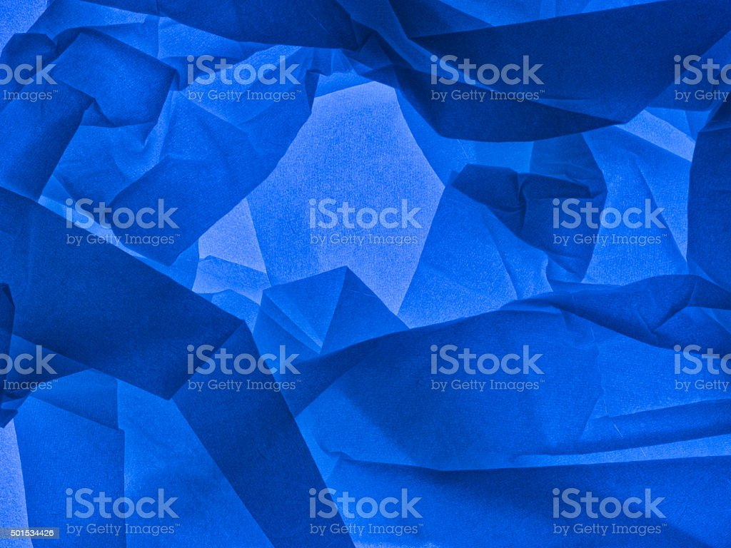 Blue abstract background. Backlit tissue paper. stock photo