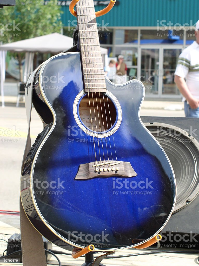 blue acoustic guitar on stand outdoors royalty-free stock photo