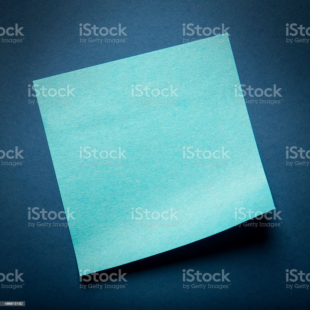 Blue adhesive note on blue background stock photo