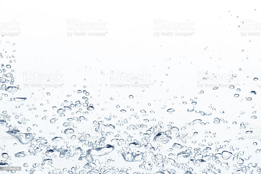 Blue air bubbles rising in clear fresh water stock photo