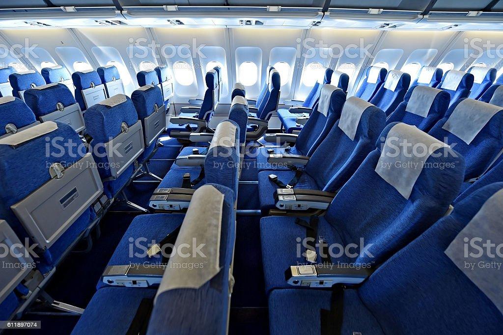 Blue airplane empty seats stock photo