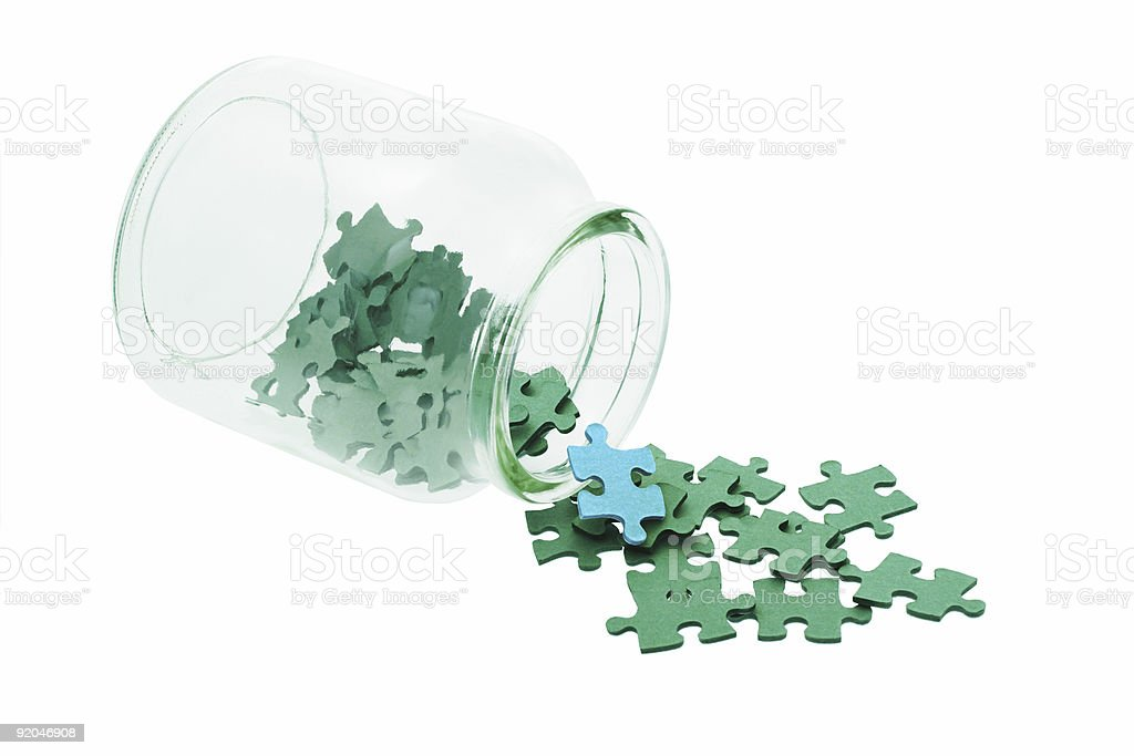 Blue among all green jigsaw puzzles royalty-free stock photo