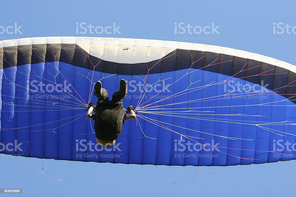 Blue and black paraglider stock photo
