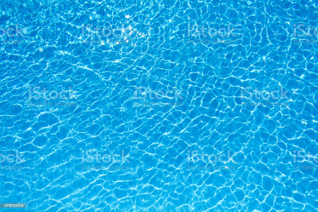 Blue and bright water surface in swimming pool stock photo