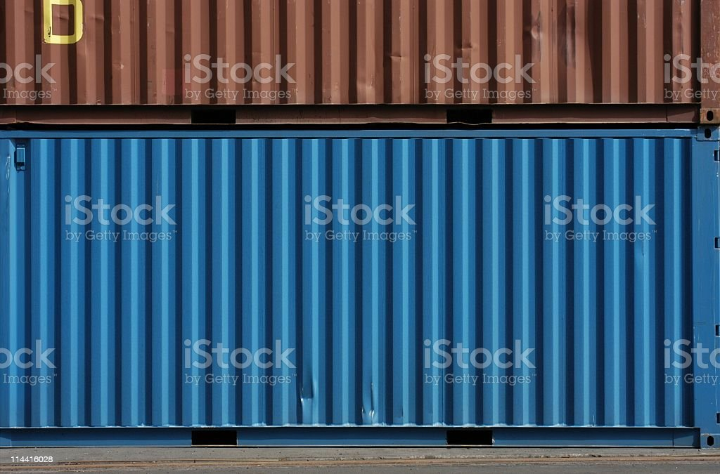 Blue and brown cargo storage containers stock photo