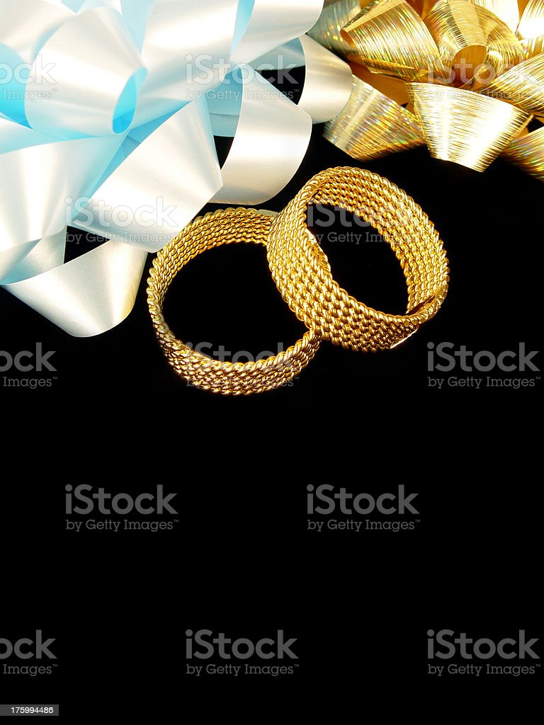 Blue and gold bows with pair of rings royalty-free stock photo