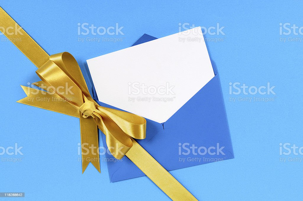 Blue and gold gift with blank greetings card royalty-free stock photo