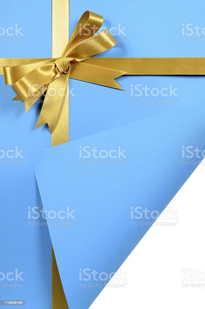 Blue and gold gift with curled corner stock photo