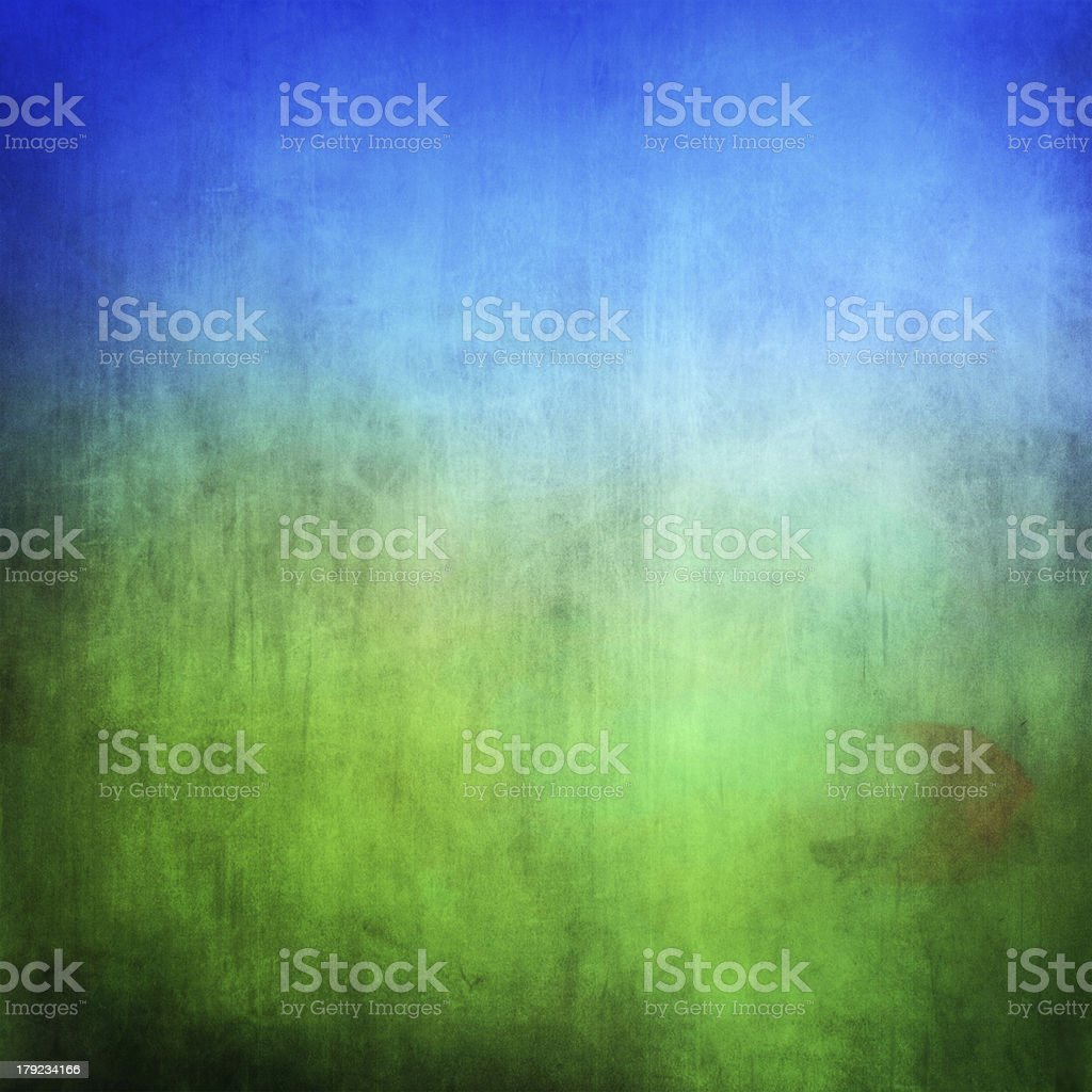 Blue and green background representing field and sky stock photo