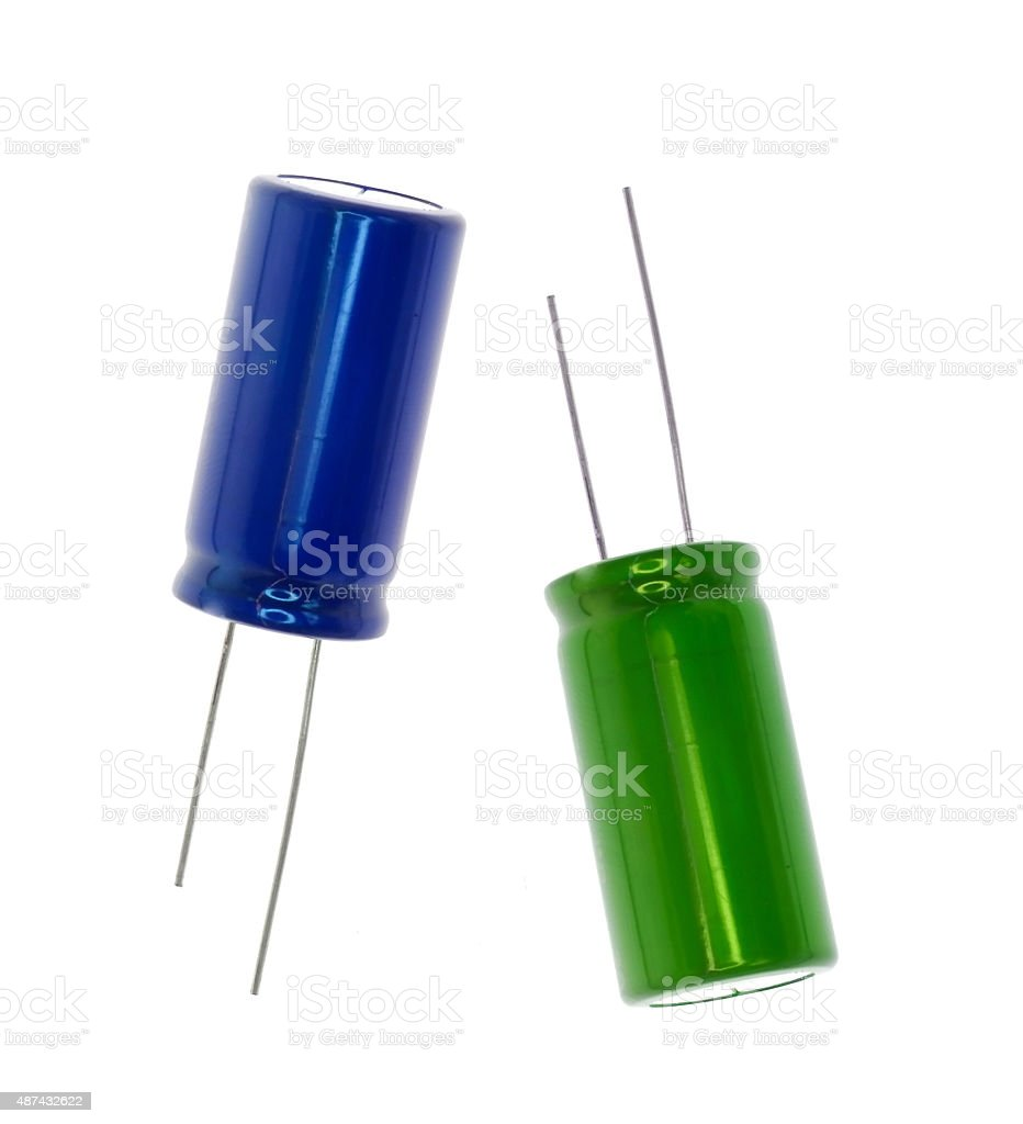 Blue and green electronic capacitor stock photo