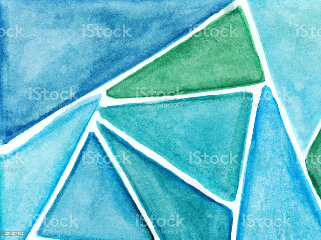 Blue and green hues of hand painted triangle shapes stock photo