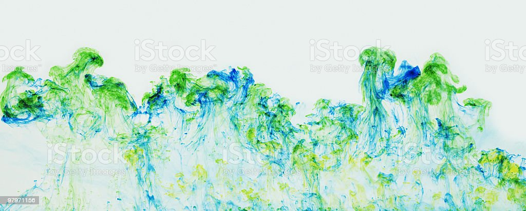 Blue and green ink suspended in water stock photo